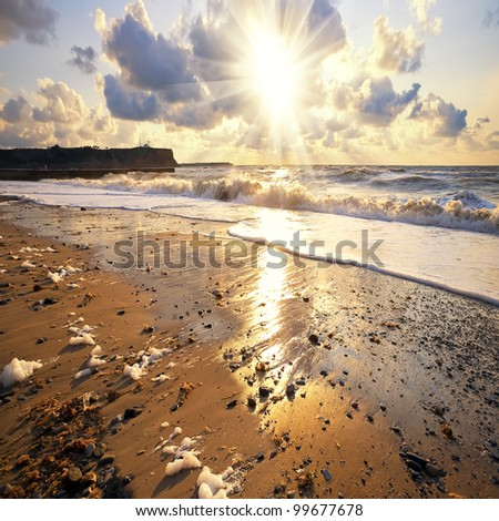 Sandy beach at sunset - stock photo