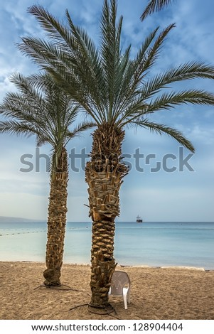 Sandy beach in Eilat - famous resort and recreation city in Israel - stock photo