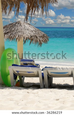 Sandy beach of tropical resort with umbrellas and chairs