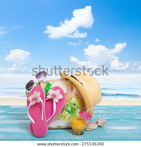 Sandy beach on sunny day with wooden walkway and beach accessories mock up for design - stock photo