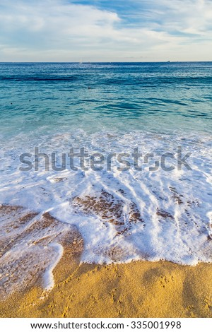 Sandy Beach View of Waves at Beach in Mexico, Cabo San Lucas - stock photo