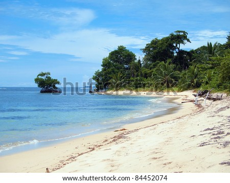 Sandy beach with a small mangrove islet and beautiful tropical vegetation, Zapatillas islands, Bocas del Toro, Caribbean sea, Panama - stock photo