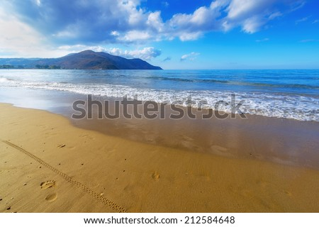 Sandy Beach  With Blue Sky In Georgioupolis, Island Crete, Greece - stock photo