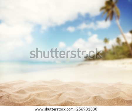 Sandy beach with blur sea on background - stock photo