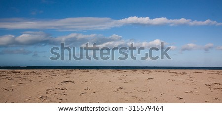 sandy beach with cloud formations in a blue sky, Turihaua, Gisborne, North Island, New Zealand  - stock photo