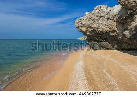 sandy beach with rocks
