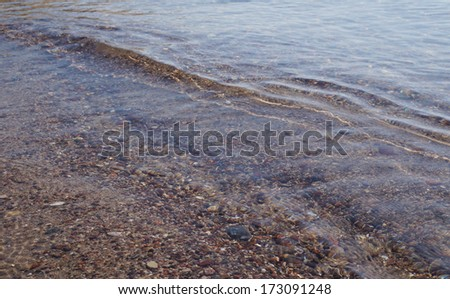 Sandy beach with sea waves