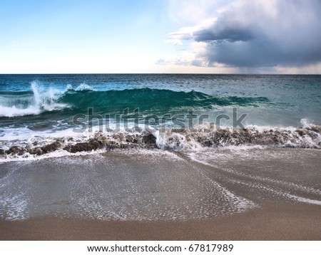 Sandy beach with waves in Barcelona, Spain