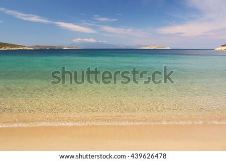 Sandy beaches of Kusadasi Region in Aegean Sea coastline of Turkey - stock photo