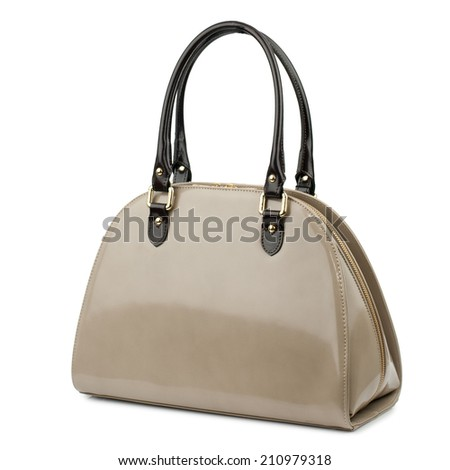 Sandy brown patent female leather bag isolated on white.