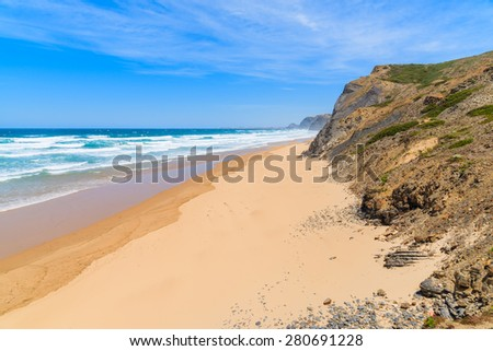 Sandy Castelejo beach, famous place for surfing, Algarve region, Portugal - stock photo