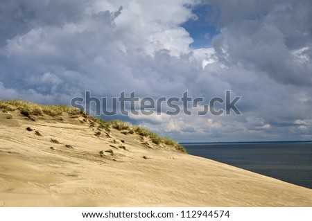 Sandy dune with the dried up grass, sunny day, Lithuania