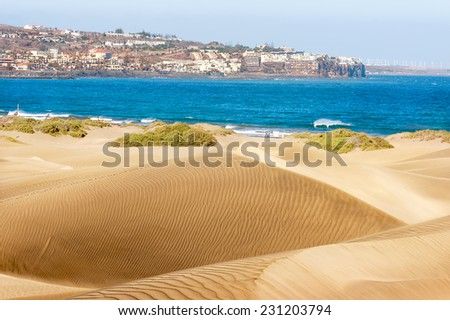 Sandy dunes in famous natural Maspalomas beach. Gran Canaria - stock photo