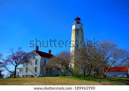 Sandy Hook historic lighthouse coastal maritime navigation aid guiding light and keepers quarters buildings at the Gateway National Recreation Area of the US Park Service on the coast of New Jersey