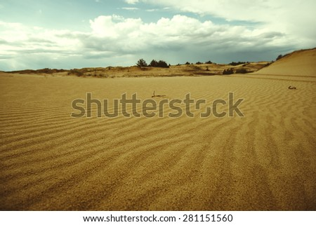 Sandy landscape in the desert. Sandy landscape in the desert. The nature of the desert and beautiful wavy sand - stock photo