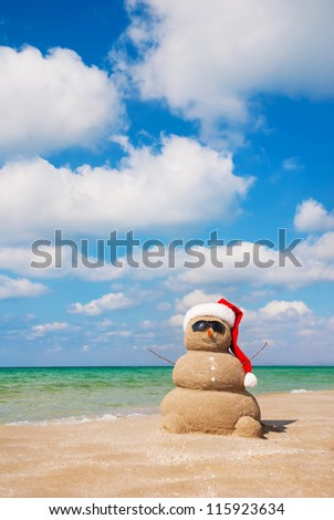 Sandy snowman. Holiday concept can be used for New Year's and Christmas Cards - stock photo