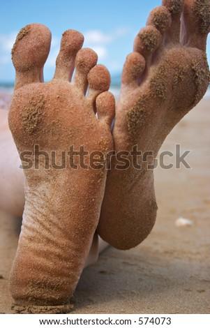 Sandy toes, kickin' back on the beach - stock photo
