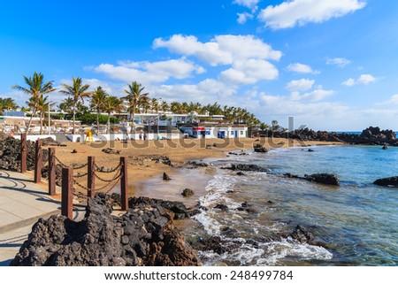 Sandy tropical beach in Puerto del Carmen seaside town, Lanzarote, Canary Islands, Spain  - stock photo