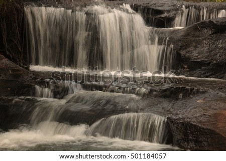 Sang Chan or Moon light Waterfall (Nam tok long roo),: Water flows through a rock waterfall. Ubon ratchathani, Thailand  in rain