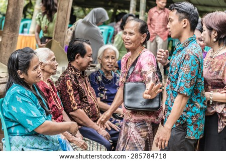 Sangalla, Indonesia - September 8, 2014: Unidentified group of people of Toraja ethnicity in traditional attire in Sangalla, Sulawesi, Indonesia. Concept of local lifestyles and traditional cultures. - stock photo