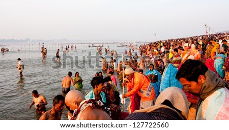 SANGAM, INDIA - JANUARY 27: Thousands of people come to holy water in the confluence of Ganges and Yamuna during the biggest festival in the world, Kumbh Mela on January 27, 2013 in Allahabad, India - stock photo