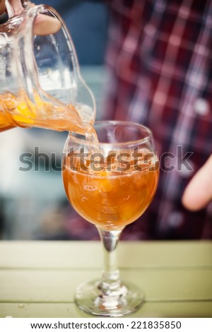 sangria, alcoholic drink with fruit, poured into a glass - stock photo