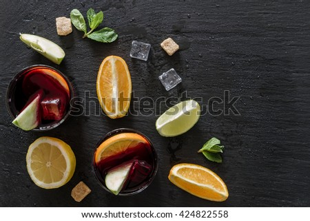 Sangria and ingredients on stone background - stock photo