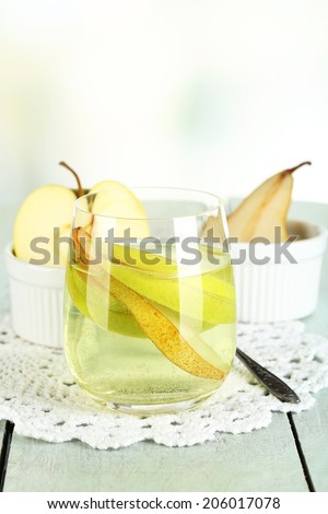 Sangria drink in glass on wooden table, on light background - stock photo
