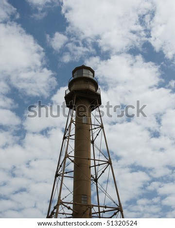 sanibel lighthouse with puffy cloud