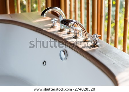 sanitary, hygiene, travel and tourism concept - close up of bathtub at exotic asian hotel - stock photo