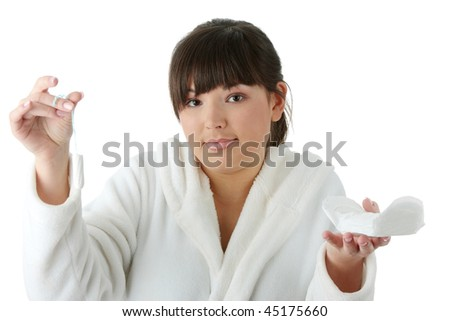 Sanitary or tampon - young woman making a choice,isolated on white