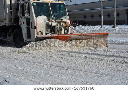 Sanitation tracks cleaning streets in Brooklyn is seen after the seasons first snow storm in NYC - stock photo