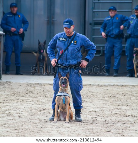 "SANKT GALLEN, SWITZERLAND - OCTOBER 22: Police demonstrates dog training on the agricultural show ""Olma"" on October 22, 2011 in Sankt Gallen, Switzerland - stock photo"