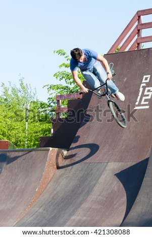 Sankt-Petereburg, Russia - May 15 2016: the man is engaged in cycle freestyle on the platform with hills - stock photo