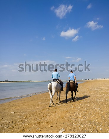 SANLUCAR DE BARRAMEDA, SPAIN - APRIL 12, 2015 -  The beaches of Sanlucar de Barrameda in the province of Cadiz come alive with the pounding of hooves as the famous horse races take over the coast.