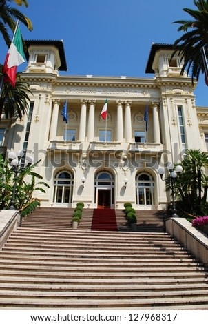 Sanremo casino white facade with palms and flowers