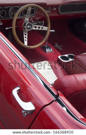 SANREMO, ITALY - MAY 13: Close up detail of a interior an Ford Mustang car of of first generation parked in a street in Sanremo, Italy on May 13, 2011. - stock photo