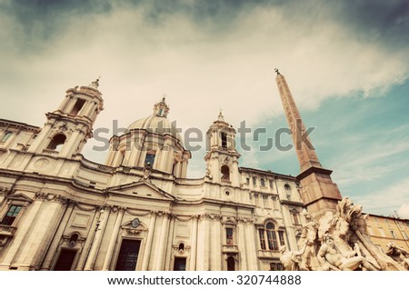 Sant'Agnese in Agone church on Piazza Navona, Rome, Italy. Egyptian Obelisk in foregroung. Vintage - stock photo
