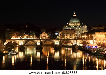 Sant' Angelo Bridge and Basilica of St. Peter at night in Rome, Italy - stock photo