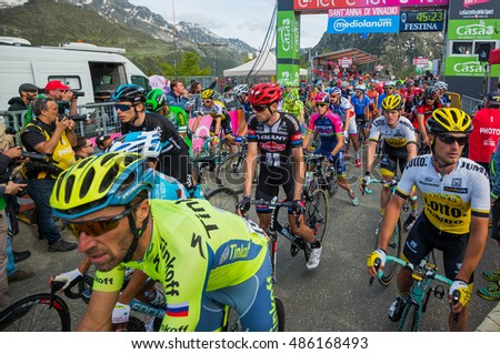 Sant Anna, Italy May 28, 2016; A Gorup of Professional Cyclists exhausted passes the finish line after a hard mountain stage with a uphill finish in Sant Anna di Vinadio.