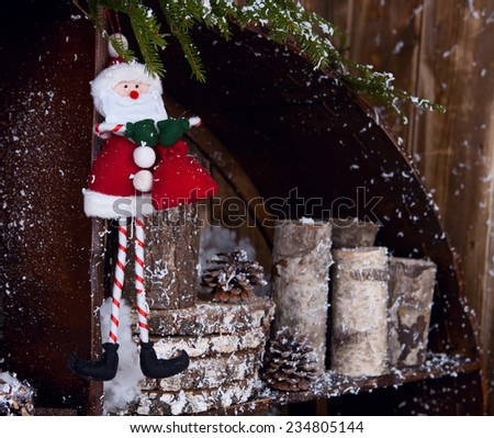 Sant Claus toy hangng on fir tree - stock photo