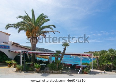 SANT ELM, MALLORCA, SPAIN - AUGUST 5, 2016: Restaurant Na Caragola by the bay on a sunny summer day in August 5 in Sant Elm, Mallorca, Spain.