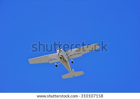 SANTA ANA/CALIFORNIA - AUG. 17, 2015: Private single engine plane approaches runway to make a landing at John Wayne International Airport in Santa Ana, California, USA