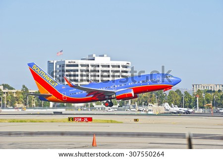 SANTA ANA/CALIFORNIA - AUG. 17, 2015: Southwest Airlines Boeing 737-700 commercial jet departs from John Wayne International Airport in Santa Ana, California, USA - stock photo