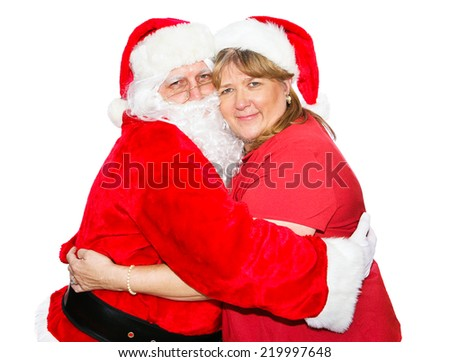 Santa and his wife hugging each other.  Isolated on white.   - stock photo