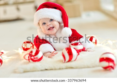 Santa baby with a gift - stock photo