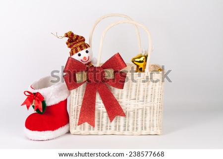 Santa bag with snowman and reindeer isolated on white - stock photo