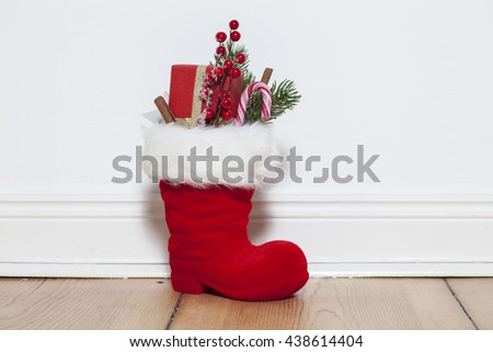 Santa Boots on floor - stock photo