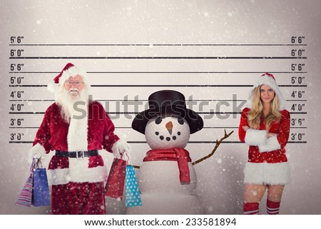 Santa carries some Christmas bags against mug shot background - stock photo
