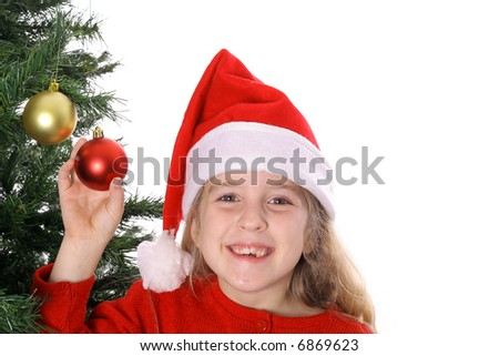 Santa child by Christmas tree - stock photo